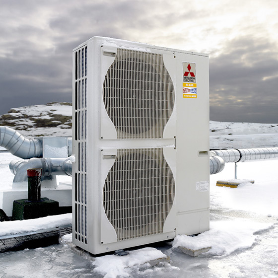 An outdoor Mitsubishi air source heat pump
