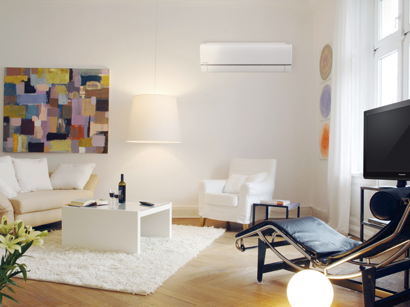 A living room benefitting from the installation of a panasonic air source heat pump
